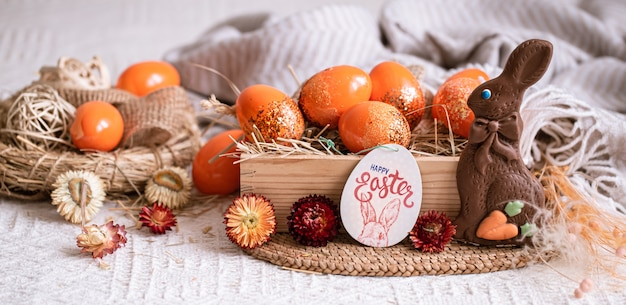 Easter still life with orange eggs, holiday decor .