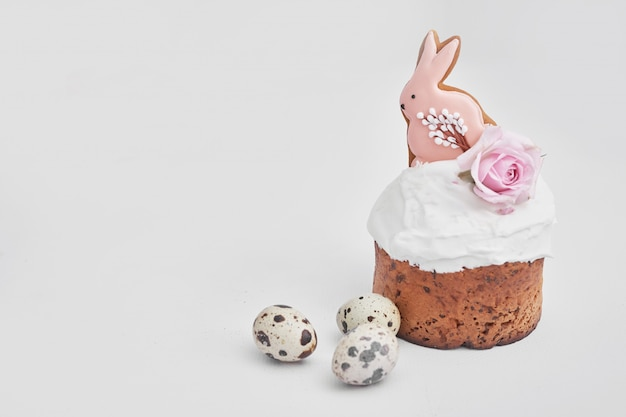 Easter sweet bread, easter cake with flowers, eggs and gingerbread. holidays breakfast concept with copy space.