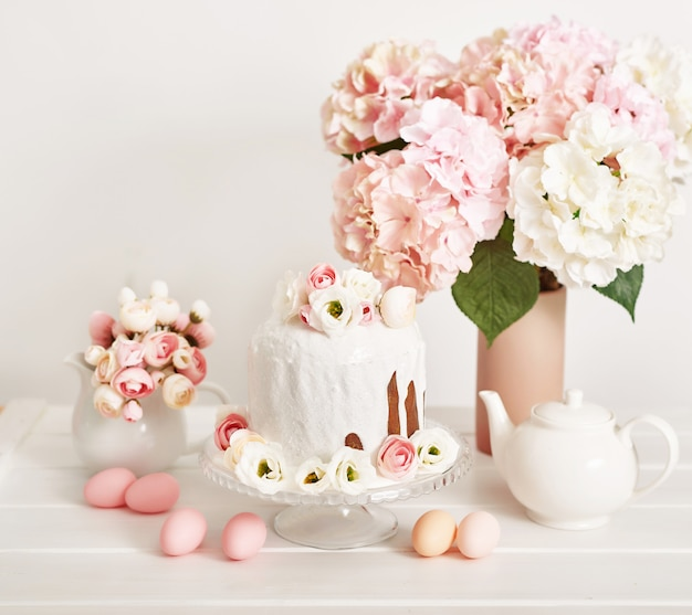 Easter sweet cake with flowers and eggs