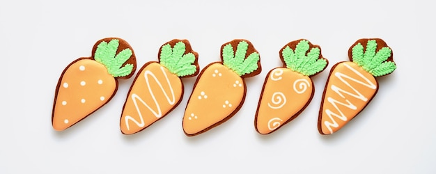 Easter symbol four carrots gingerbread isolated on white. banner. top view.