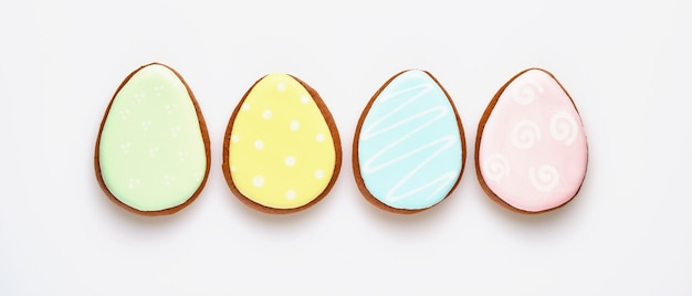 Easter symbol four colorful gingerbread egg isolated on white. banner. top view.