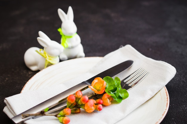 Easter table setting with spring flowering branches.