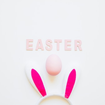 Easter word with bunny ears and egg