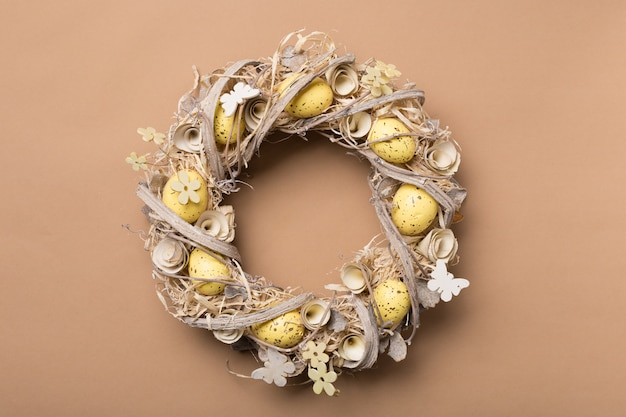 Easter wreath made of eggs om beige background. copy space.
