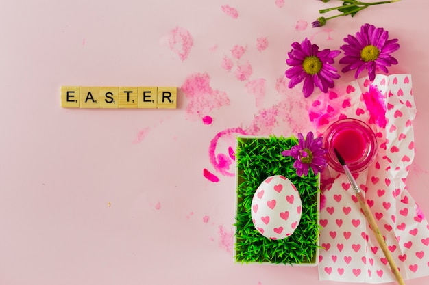 Easter writing near egg and paint