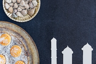 Eastern sweets and mosque towers cut out of paper
