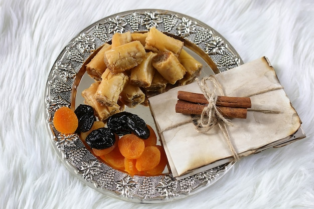 Eastern sweets table on a silver platter baklava and tamarind snack at the workplace