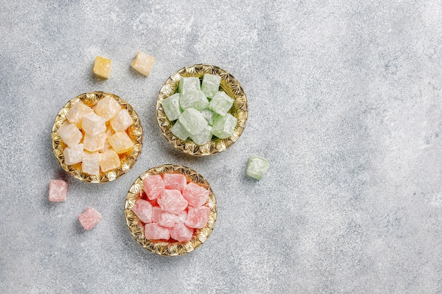 Eastern sweets. turkish delight, lokum with nuts, top view.