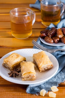Eastern sweets with dates fruit and tea