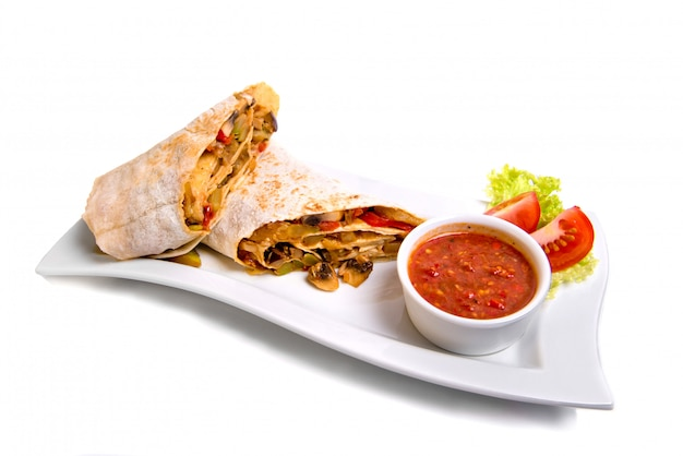 Eastern traditional shawarma plate with sauce isolated on white.