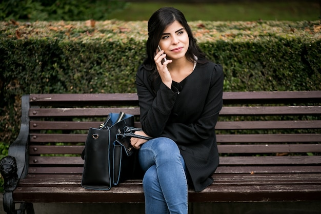 Eastern woman with phone
