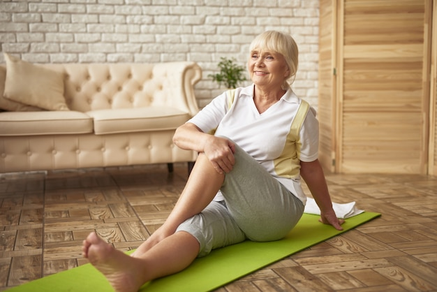 Easy workout for retired woman rehabilitation.