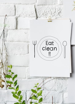 Eat clean food inspiration on paper poster on white wall