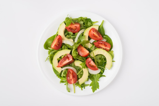 Eating clean concept. top above overhead close-up view photo of a salad with olive oil plate placed in the center isolated on white background