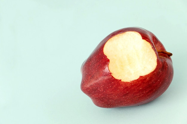 Eating a red apple fruit,  it's yummy for diet healthy