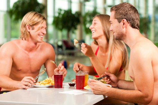 Eating in restaurant at public swimming pool