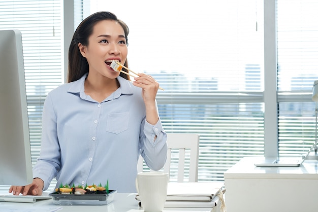 Eating sushi at workplace