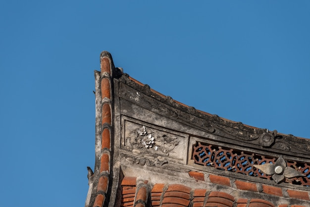 Eaves and corners made of red tiles in traditional chinese ancient houses