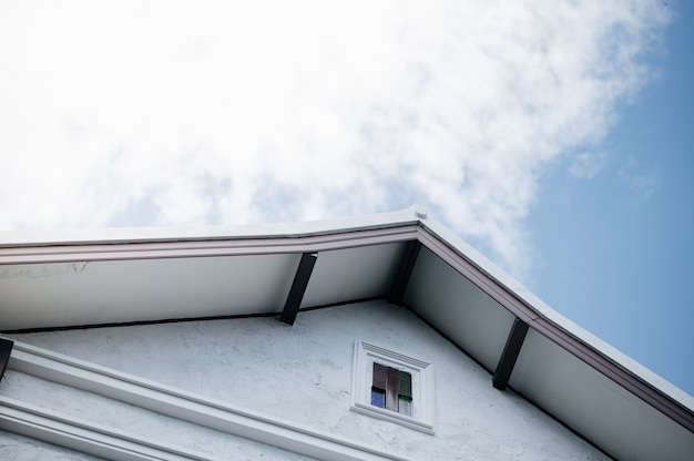Eaves with white clouds and blue skies