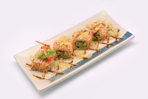 Ebi tempura maki roll (sushi shrimp tempura roll) in square plat