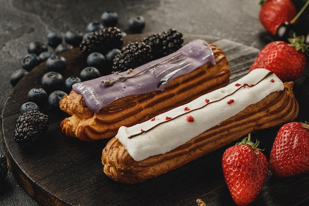 Eclair cake with glaze decorated with berries