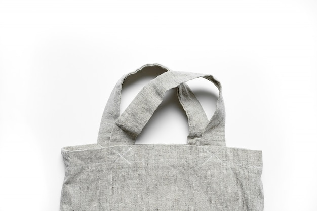 Eco-bag made of linen and cotton on white table.