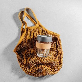 Eco bag and reusable coffee mug. sustainable lifestyle. plastic free concept.