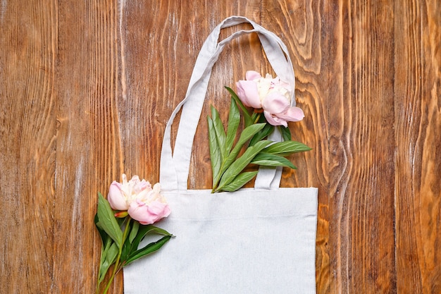 Eco bag with flowers on wooden