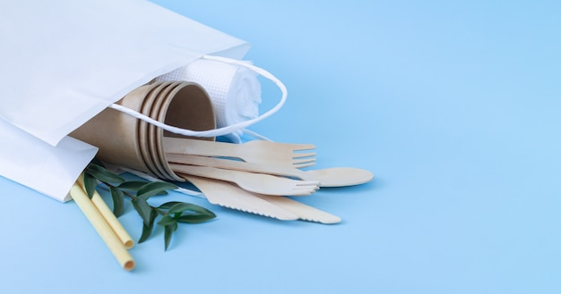 Eco biodegradable tableware and cutlery in paper bag