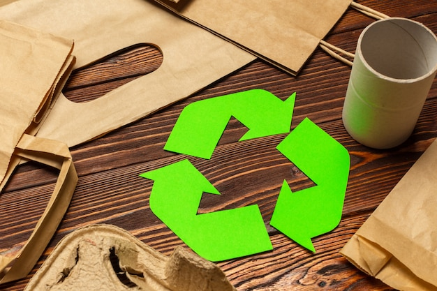 Eco concept with recycling symbol on table top view