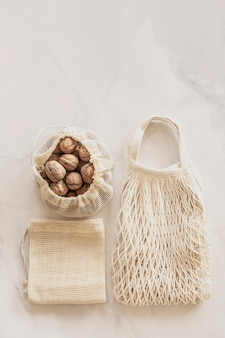 Eco friendly accessories  eco bags and walnuts zero waste plastic free concept sustainable lifestyle top view flat lay