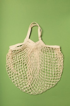 Eco-friendly bag, string bag on a green surface