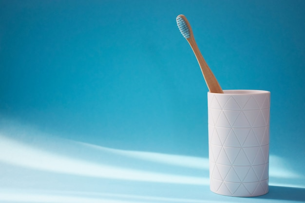Eco friendly bamboo toothbrush in white holder