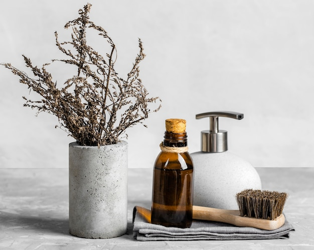 Eco-friendly cleaning products set on table with brush