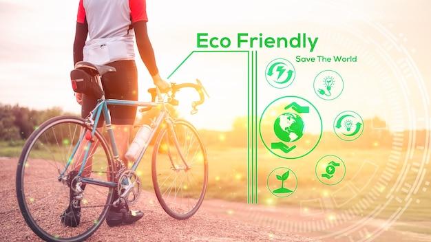 環境にやさしいコンセプト、グリーンエネルギー、二酸化炭素削減、汚染削減。世界を救い、地球を救うためのカーフリーデーのコンセプト。自然の中で自転車に乗る男。