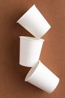 Eco-friendly cups flat lay