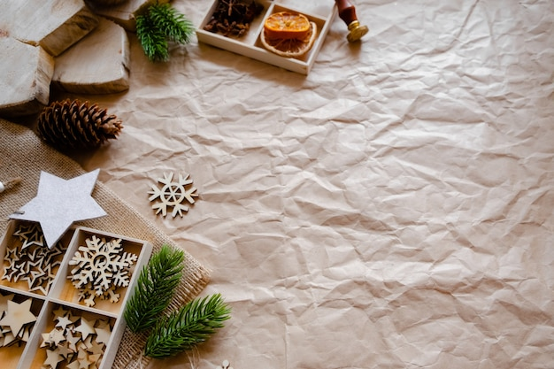 Eco friendly decorations with craft paper and wooden toys, flat lay