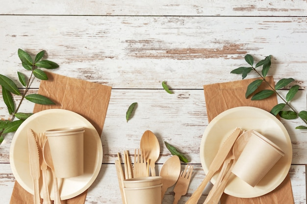 Eco friendly disposable dishes made of bamboo wood and paper on white