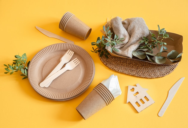 Eco friendly disposable dishes made paper on an orange surface