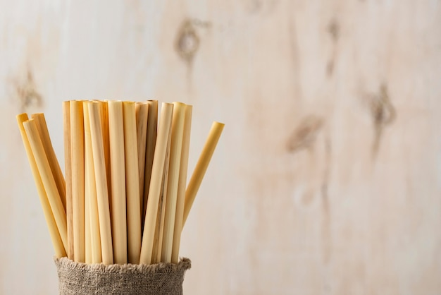 Eco-friendly environment bamboo tube straws copy space