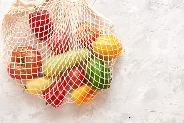 Eco friendly mesh bag with fruit and veggies.