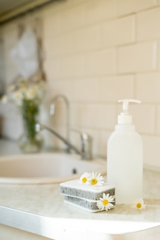 Eco friendly nontoxic cleaning dish soap with chamomile flowers clean white plates