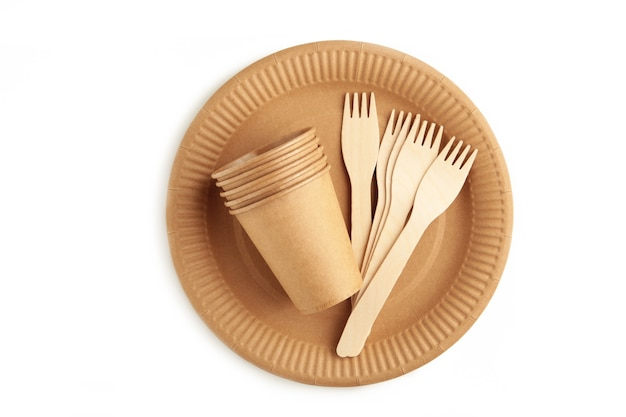 Eco - friendly plate with fork and glasses isolated on white background. disposable tableware. top view
