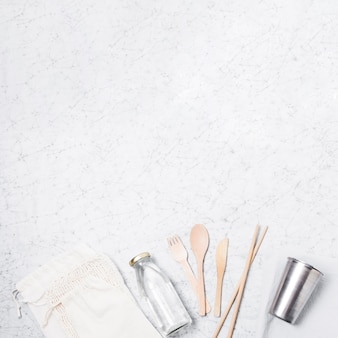 Eco friendly products on marble background with copy space