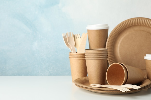 Eco - friendly tableware on white, space for text