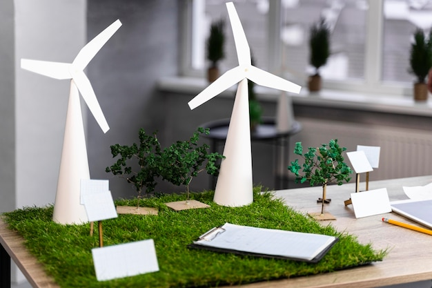 Eco-friendly wind power project layout on desk with smartphone