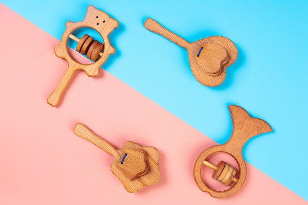 Eco-friendly wooden toys, rattles in the form of a heart, fish, stars, bear