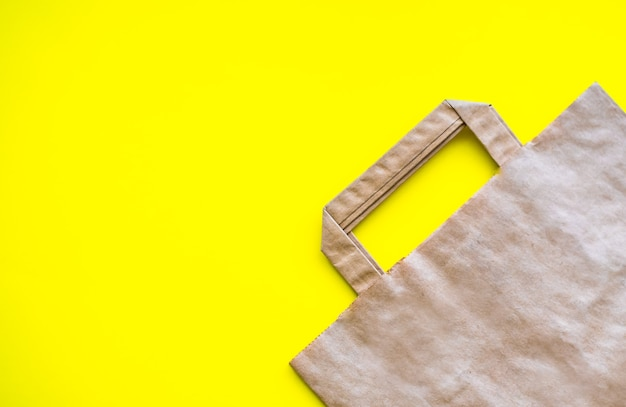 Eco grocery bag on a yellow background