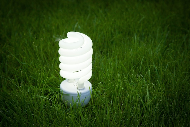 Eco lamp lights on grass background