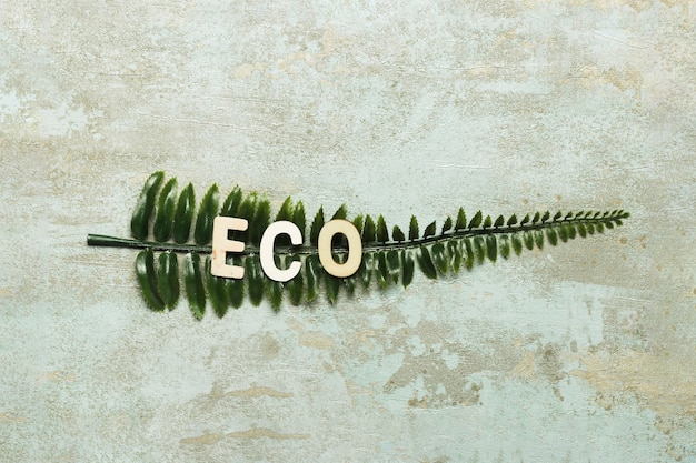 Eco lettering on green fake leaf